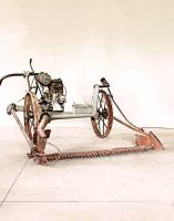 Motofalciatrice con ruote in ferro.