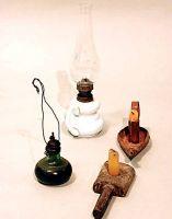 Lampade a petrolio (canfìni) da tavolo, a soffitto e bugie o candelieri a piatto.